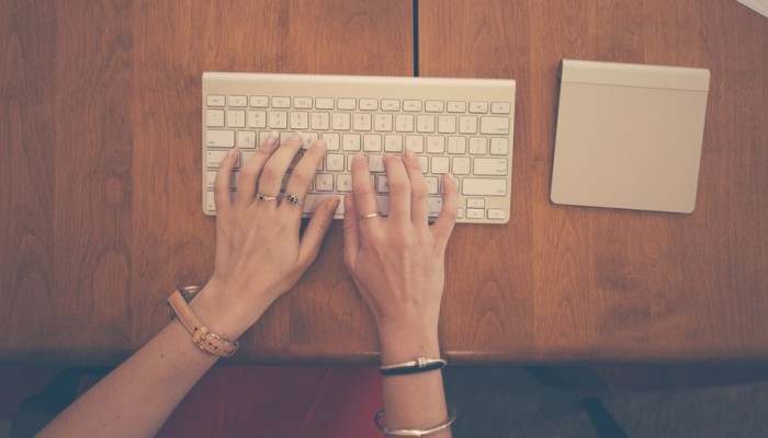hands-woman-apple-desk-large